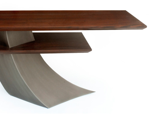 Elm 2 is a contemporary dining table made out of steel and mahogany measuring 66 x 20 x 30 inches made by Chad Manley Design.